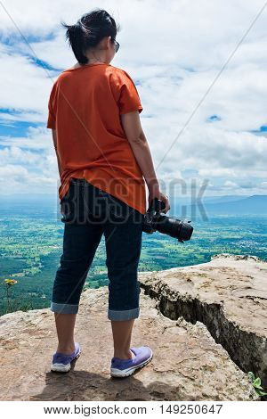 Asian Woman With Digital Camera, Outdoor At The Daytime On Summer Day.