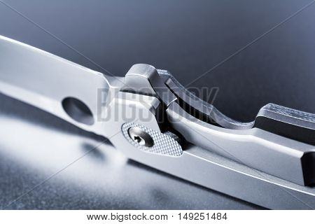 Standing Faint Military Knife On Dark Ground With Reflection