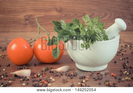 Vintage Photo, Parsley In Mortar And Spices With Vegetables On Rustic Boards