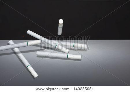 Group white cigarette on black background .