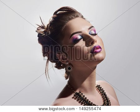beautiful young woman portrait with bright mak up