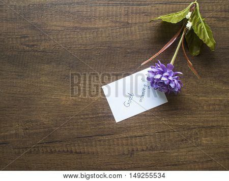 Flower and piece of paper with text