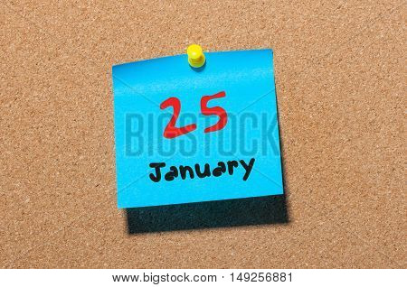 January 25th Eve Christmas. Day 25 of month, Calendar on cork notice board. Winter New Year time. Empty space for text.