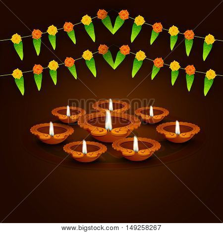 Creative Oil Lamps (Diya) on traditional mango leaves buntings decorated brown background for Indian Festival of Lights, Happy Diwali celebration.