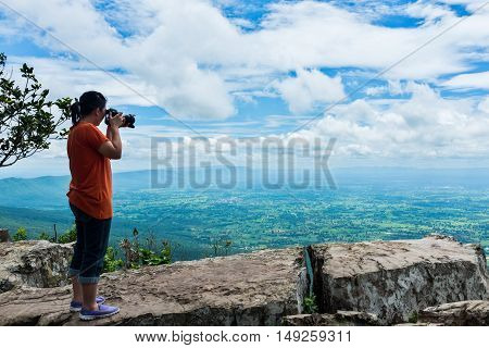 Asian Woman Photographed The Beautiful View, Outdoor On Summer Day.