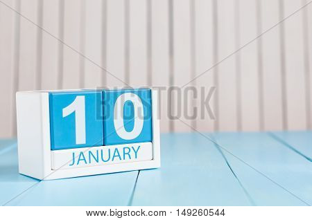 January 10th. Day 10 of month, calendar on wooden background. Winter concept. Empty space for text.