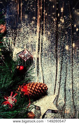 Christmas fir tree on dark wooden board with festive decoration - Merry Christmas and Happy New Year Card.