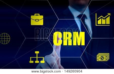 business technology internet and customer relationship management concept. Businessman pressing crm button on virtual screens.