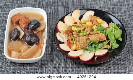 Chinese Vegetable festival  food as fried ginkgo with mixed vegetables served with streamed Chinese medicine herb soup ,