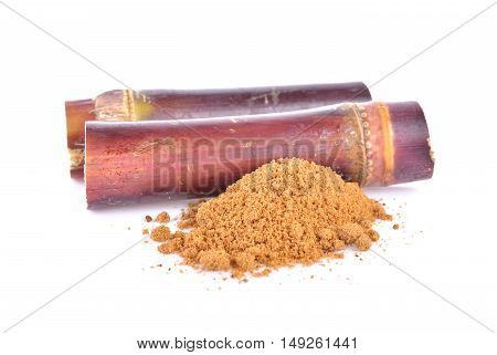sugar cane and brown sugar on white background