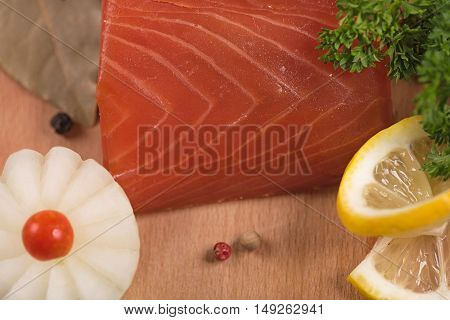 Smoked salmon fillet with vegetables on the cutting board