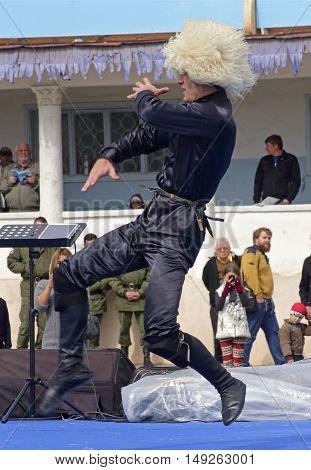 PYATIGORSK,RUSSIA - SEPTEMBER 25,2016:Unknown member of the popular band ''Zolotoe runo'' performs the dance highlanders,hippodrome in Pyatigorsk,Caucasus,Russia on September 25,2016.