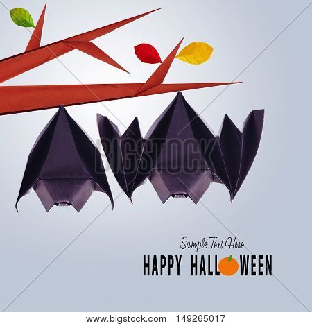 Origami paper halloween hanging bats couple on a branch on blue background