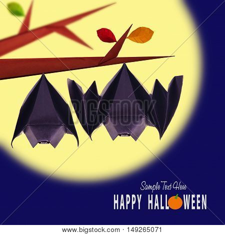 Origami paper halloween hanging bats couple on a branch on moon night background