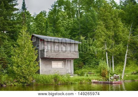 Lonely wooden cottage on a northern Ontario lake, Canada.