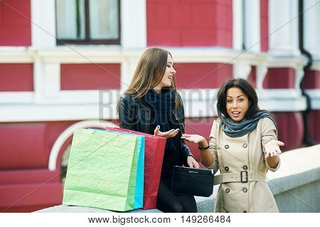 happy girls ,watch something in the bag after a shopping trip