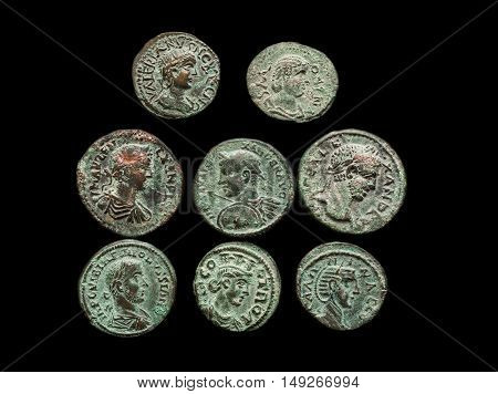 Pile Of Ancient Roman Copper Coins Isolated On Black