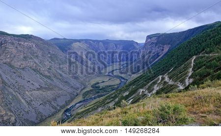 Mountain serpentine pass Katu-Yaryk from Ulagan Highlands to the waly of river Chulyshman in Altai mountains. Siberia Russia