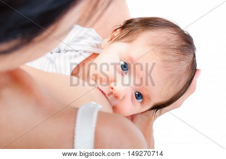 Portrait of a cute baby at the breast of mother isolated on white background