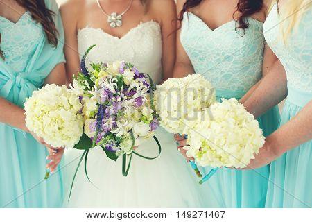Close up of bride and bridesmaids bouquets (bridesmaid)