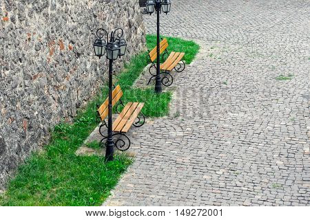Two empty benches under the streetlights in a quiet location copy space