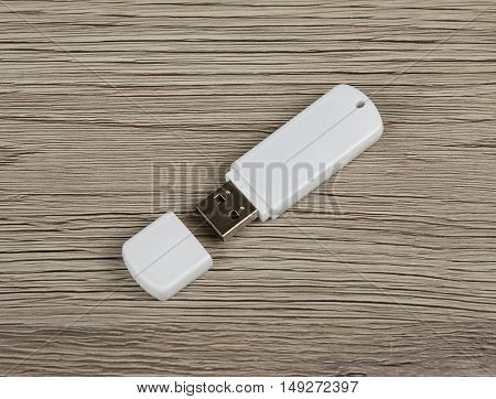 White usb flash drive on wooden background