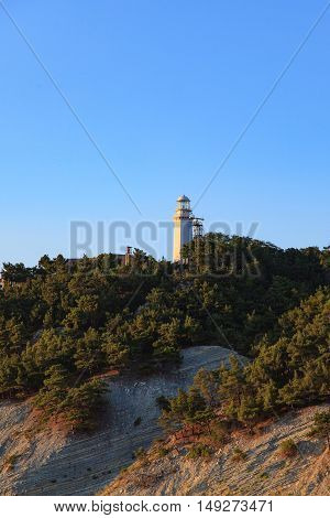 white lighthouse with a blue sky in day