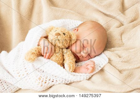Baby girl sleeping tugged in a blanket