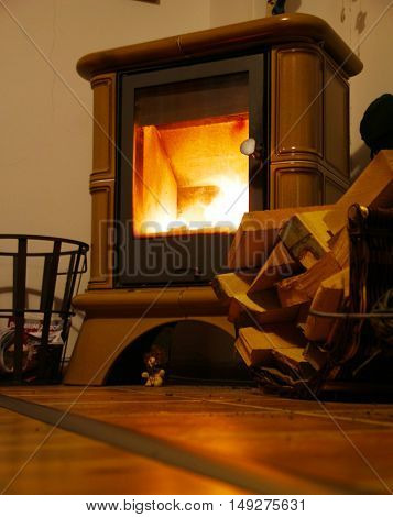 A new cast iron wood stove burning hot with slate tile