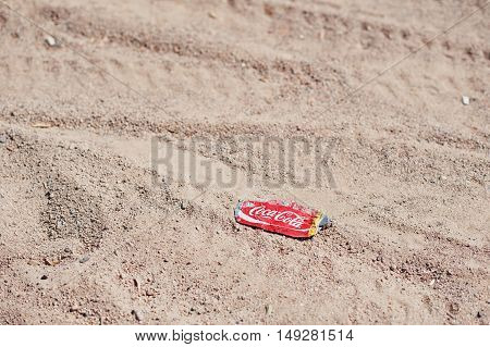 Hurghada, Egypt -20 August 2016: Crumpled Coca Cola Cans At Sand.