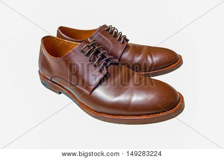 Male brown shoes isolated on white background.