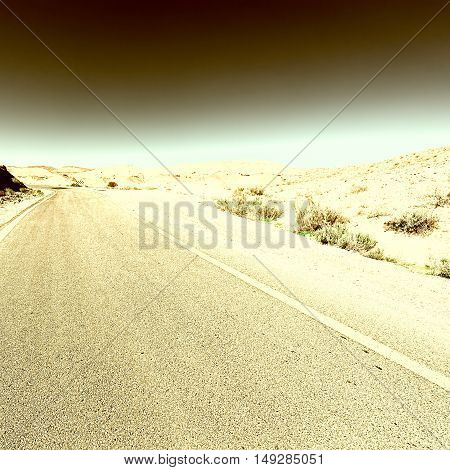 Winding Asphalt Road in the Negev Desert in Israel Vintage Style Toned Picture