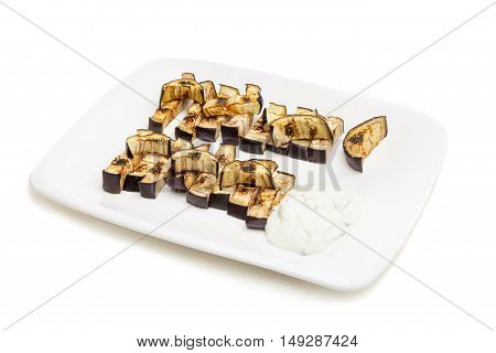 Platter of grilled eggplant with tzatziki sauce