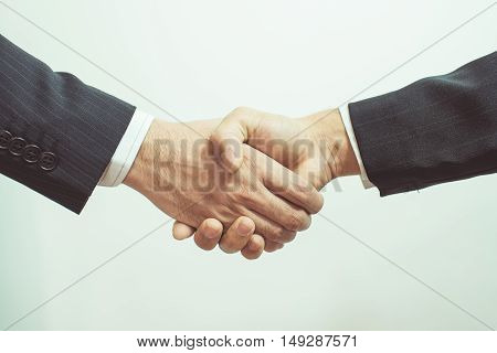 Business Man. Business handshake and business people vintage tone