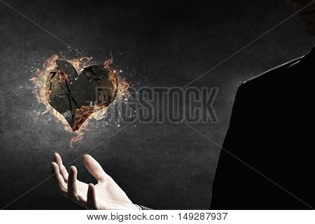 Heart burning in fire . Mixed media