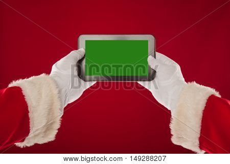 Santa Claus is holding a plate with a green background. Red background. christmas