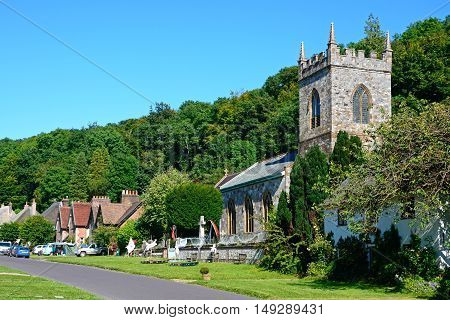 MILTON ABBAS, UNITED KINGDOM - JULY 19, 2016 - View along the pretty village street with the church in the foreground Milton Abbas Dorset England UK Western Europe, July 19, 2016.