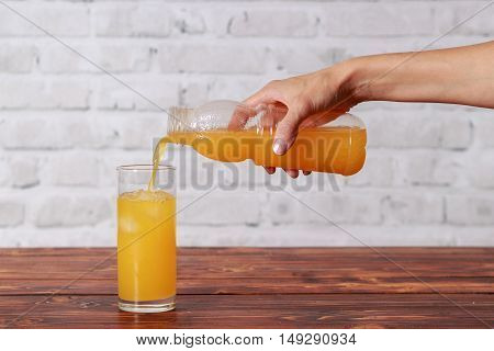 Girl pouring tasty fresh yummy orange juice