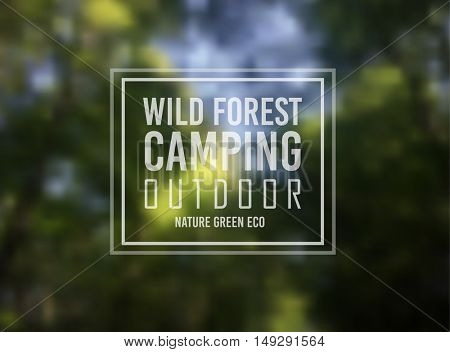 Wild Forest Nature Camping Typo Motivational text over a blurred forest background