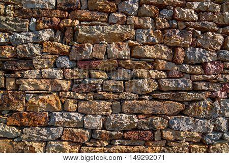 Modern stone brick texture wall background in autumn