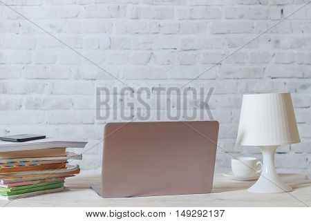 Laptop and black smarthone on working place in home