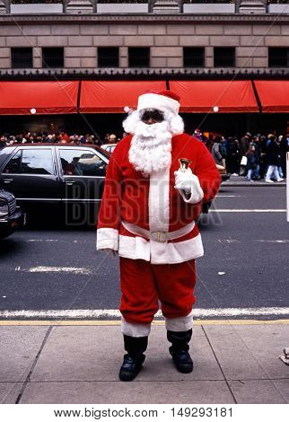 NEW YORK, USA - DECEMBER 9, 1994 - Father Christmas along 5th Avenue at Christmas with Saks to the rear New York USA, December 9, 1994.