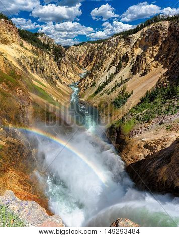 Rainbows at Lower Falls on the Grand Canyon in Yellowstone National Park, WY, USA