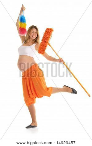 happy pregnant woman with a mop and brush