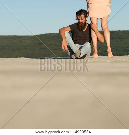 Man Sits Near Female Legs