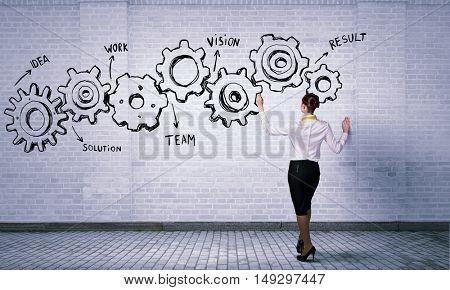 Woman presenting teamwork concept . Mixed media