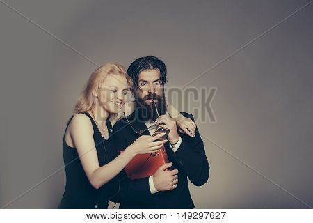 Astonished Couple Look In Smartphone