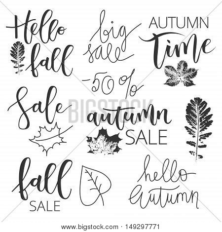 Autumn sale black hand written inscriptions and leaves icons on white background