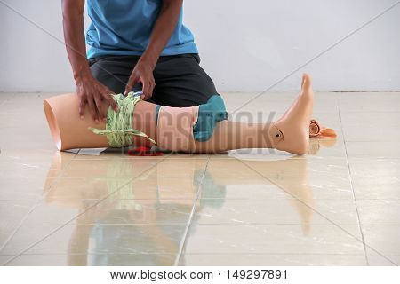 medical dummy receiving CPR refresher training to assist of physician