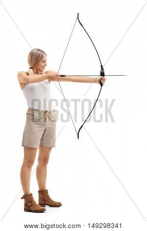 Full length profile shot of a woman aiming with a bow and arrow isolated on white background